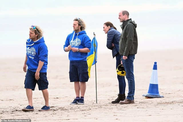 The Duke and Duchess of Cambridge looked on at a group of young carers taking part in the land yachting