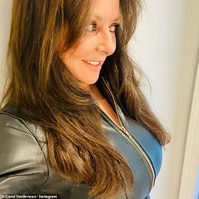 Hitting the town: Carol Vorderman said she is a 'happy girl at last' as she celebrated the lockdown restrictions easing on Wednesday