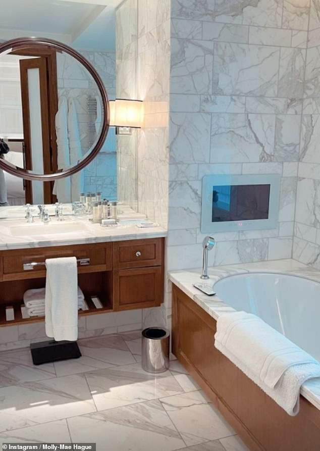 Got any bubble bath? The suite's bathroom was covered with white marble and a tiled floor