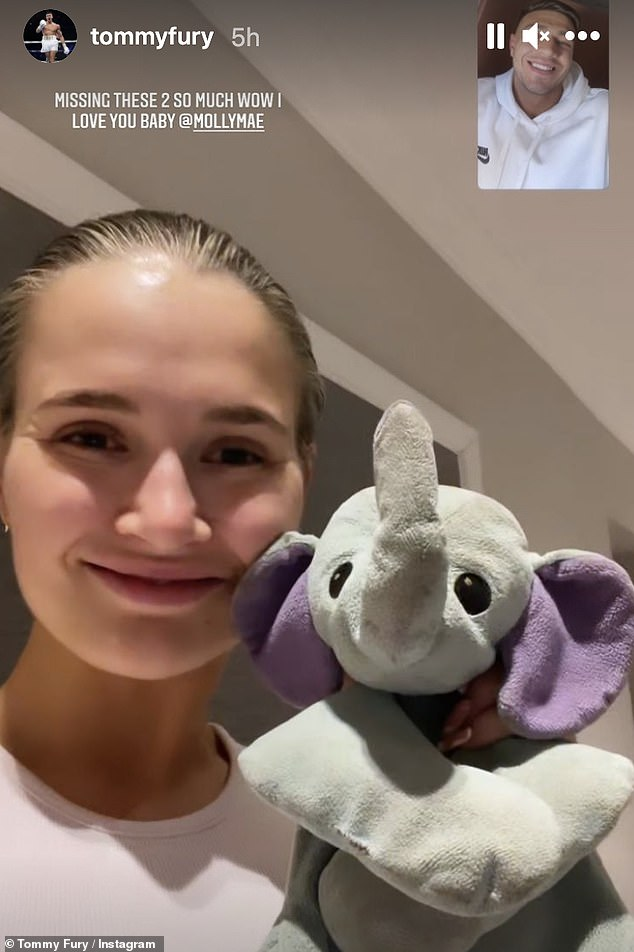 Cute:The boxer then shared a snap of himself on a Facetime call with a make-up free Molly-Mae who can be seen holding up her favourite teddy bear, Ellie Belly