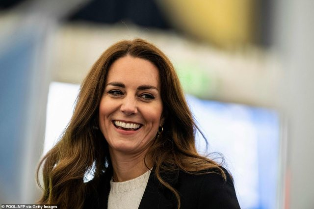 Light-hearted moment: Kate smiled as she spoke to students during her visit to the university today