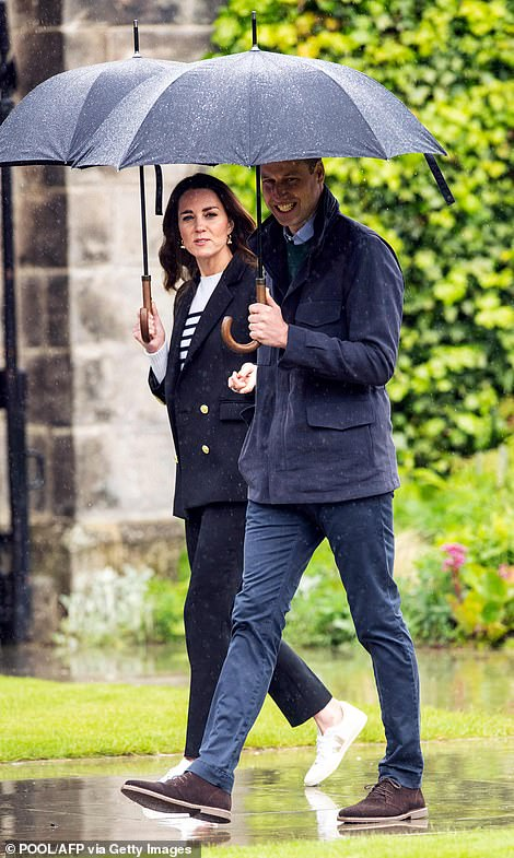 Trip down memory lane: The Duke and Duchess of Cambridge chatted as they walked through the grounds of St Andrews