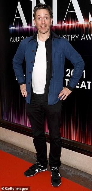 Funny man: Comedian and radio presenter John Robins went for a smart/casual look