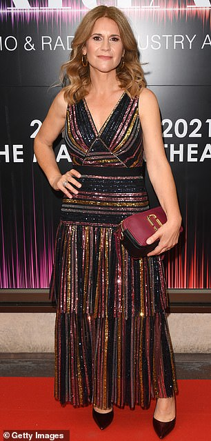 Glam: Harriet Scott sparkled in a plunging metallic layered number