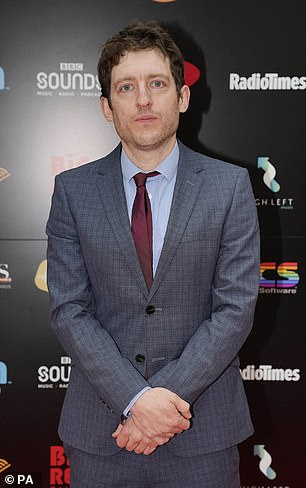 Suited up: Elis James wore a suit over a blue shirt and burgundy tie