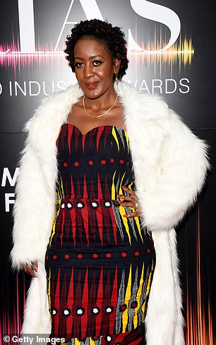 Stunning: Brenda Birungi looked sensational in a white fur over a figure-hugging yellow, red and black patterned dress