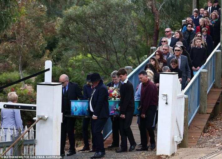 Lauren was led out of her funeral and into the hearse first, with hundreds of mourners following behind (pictured)
