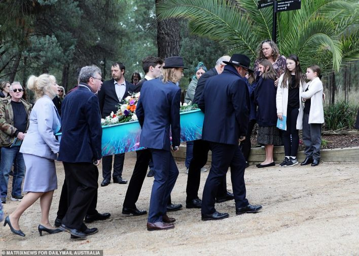 Lauren's turquoise coffin with purple butterflies was eventually carried in by her older brother, Owen, and five other family members