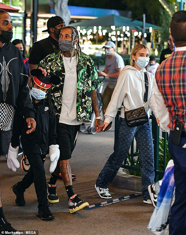 Loved up:Tyga and girlfriend Camaryn Swanson were seen holding hands while enjoying a day at Disneyland in Anaheim, California on Wednesday