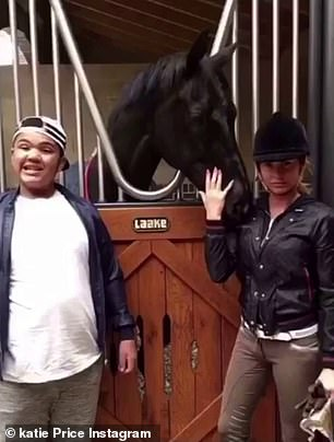 Horsing around: While the duo also posed alongside a black horse in another image