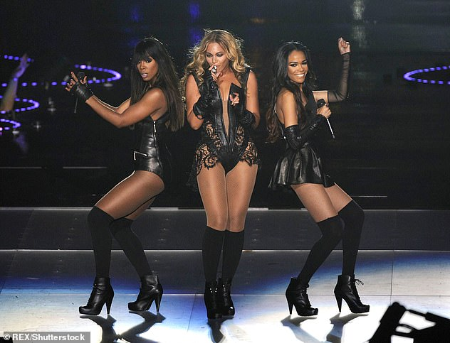 Amazing:The singer, 41, took to Instagram to share the videos as she joked it was the Destiny's Child reunion people have been 'waiting for' (pictured in 2013 - L to R, Kelly, Beyonce and Michelle)