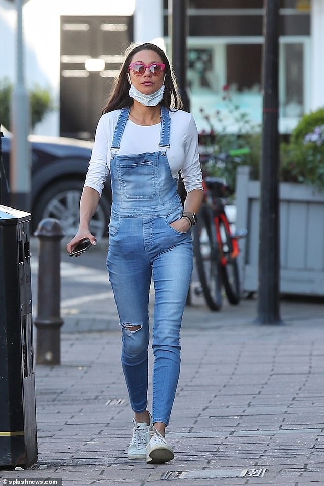 Out and about: Boris Becker's ex-wife Lilly Becker stepped out in London on Thursday in denim dungarees and a white crop top
