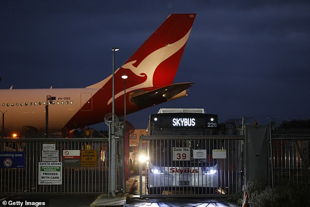 Returning travelers from Covid-stricken India are taken straight from the plane to quarantine in hotels on May 27, in Melbourne - despite the city being hours away from lockdown