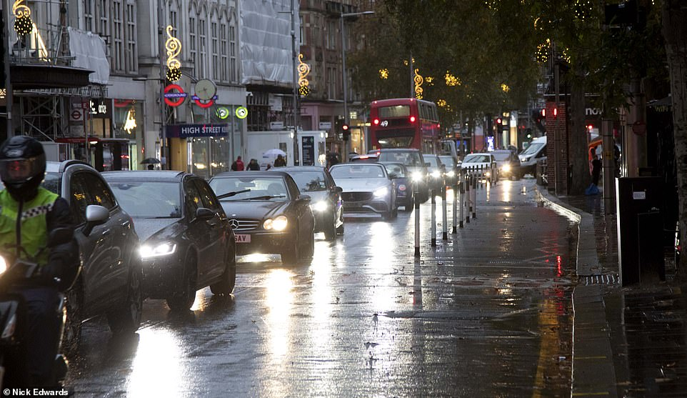 Cycle lane bollards placed on Kensington High Street in West London caused traffic chaos last year before being removed