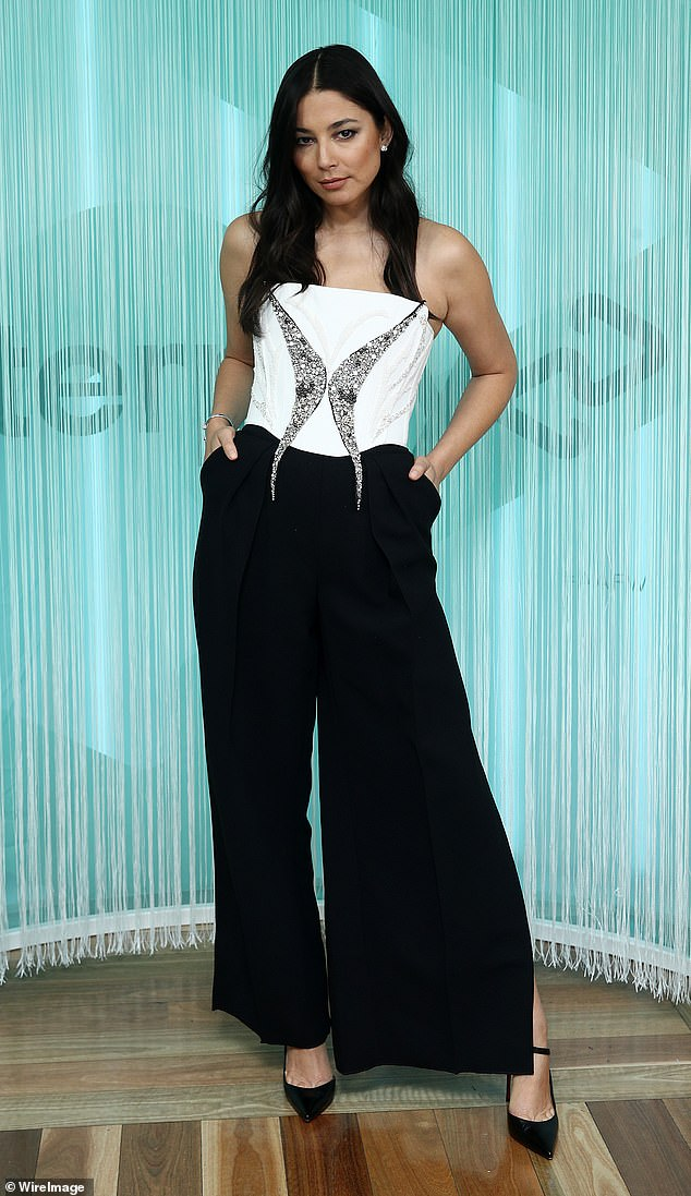 Hot:Jessica, 35, wowed in high-waisted black pants and a white bodice that was adorned with a giant, dazzling butterfly-shaped broach