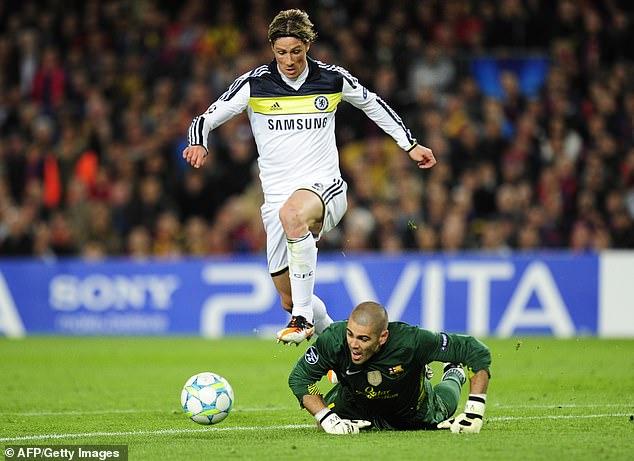 Fernando Torres rounds Barcelona goalkeeper Victor Valdes to seal victory for Chelsea in 2012