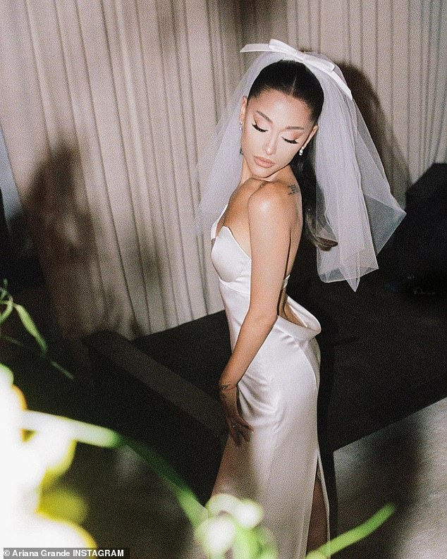More on this:It was a 'personal high point' for the 27-year-old singer. Vogue magazine, who have published a number of photos from the wedding, revealed: 'As the lyrics of Thank U, Next predicted ('One day I'll walk down the aisle / Holding hands with my mama'), Ariana's mother, Joan Grande, gave her away. 'Although in real life she did so alongside Ariana's father, Ed Butera'