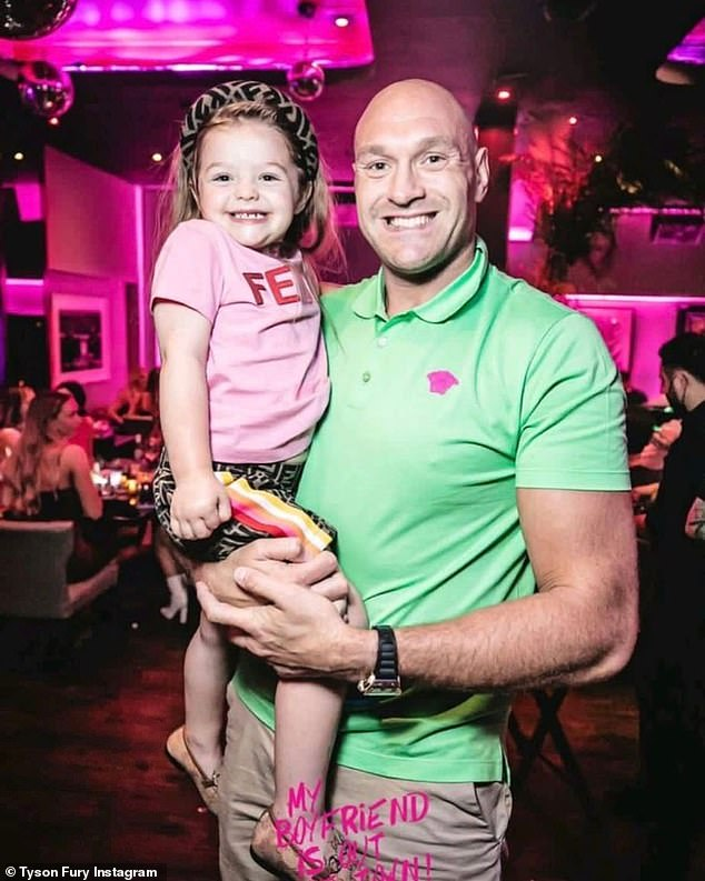 Sweet:Tyson Fury was every inch the doting father on Wednesday night as he danced with his two daughters during a fun night at Bâoli Miami restaurant