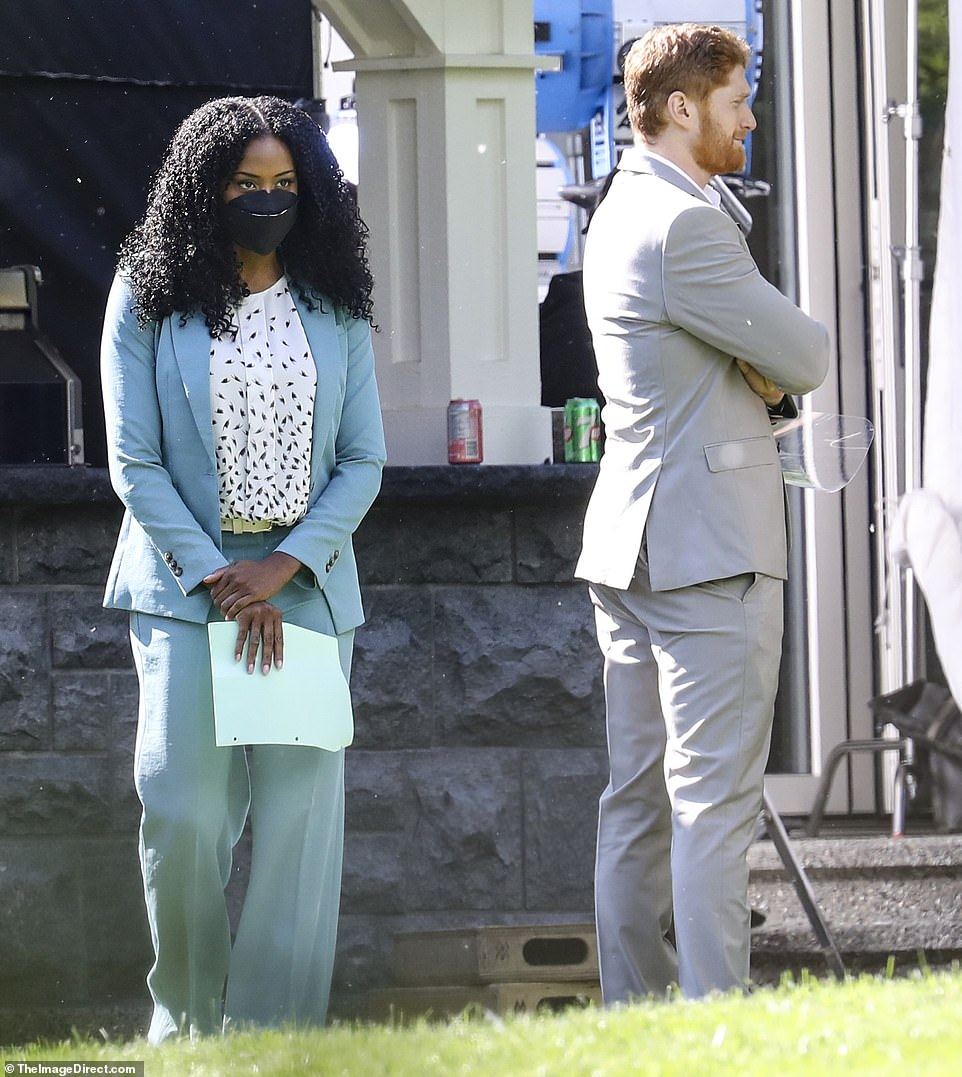 Co-star? Dean was also seen standing alongside another woman who looked elegant in a teal suit. It is not known whether she is a member of the cast, or whether she is part of the crew