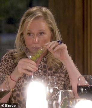 Kathy seen taking her third drink