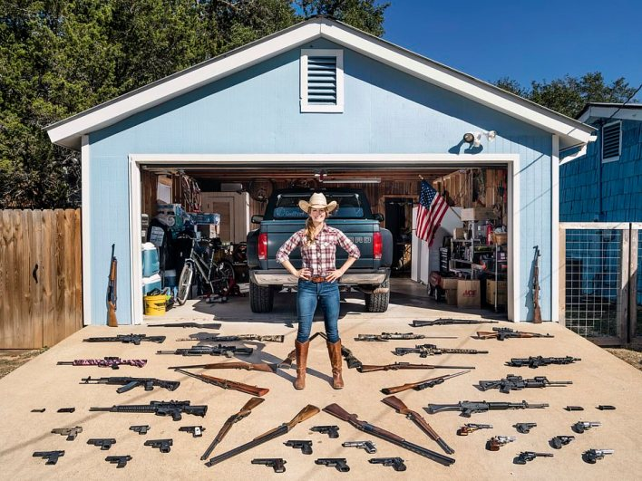 Katie, 41, displays her firearm collection after movingto Texas because of crackdowns on gun ownership in her native state of California
