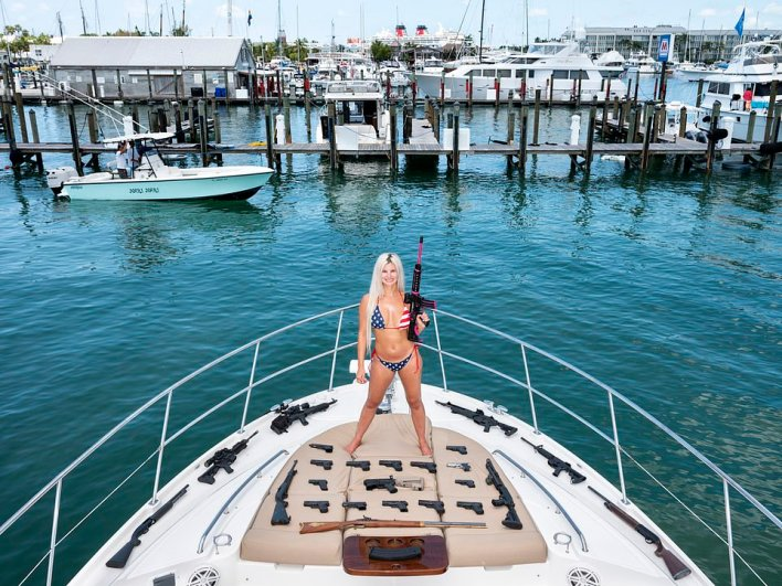 Instagram influencer Brickell Clark, 36, poses on a yacht with her gun collection