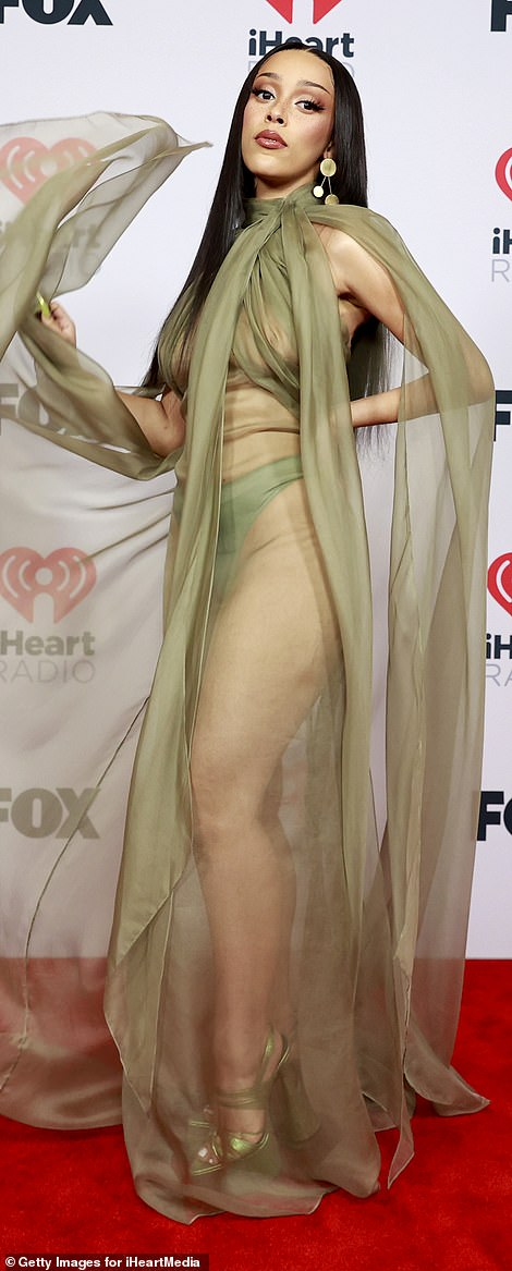 Strategic: The 25-year-old songstress protected her modesty with a pair of green high-legged panties and strategically placed fabric on the chest