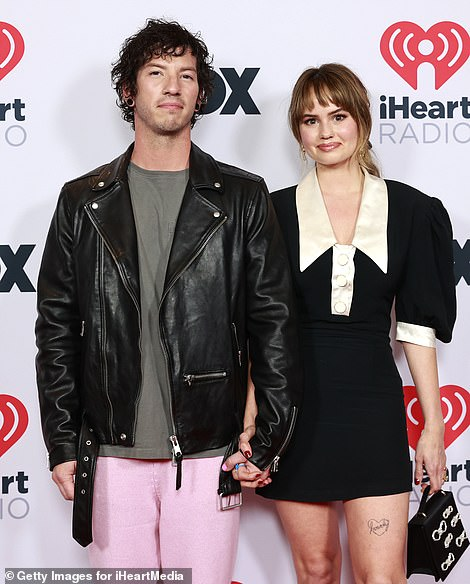Lovebirds: Twenty One Pilots frontman Josh Dun, rocking a leather jacket and pink trousers, posed for red carpet snapshots with his wife Debby Ryan