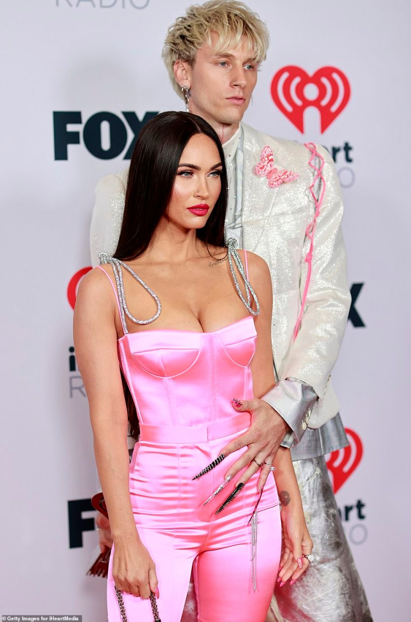 Goddess:Megan Fox looked like a glowing goddess in a bright pink jumpsuit as she showed up in support of her rockstar beau Machine Gun Kelly on Thursday