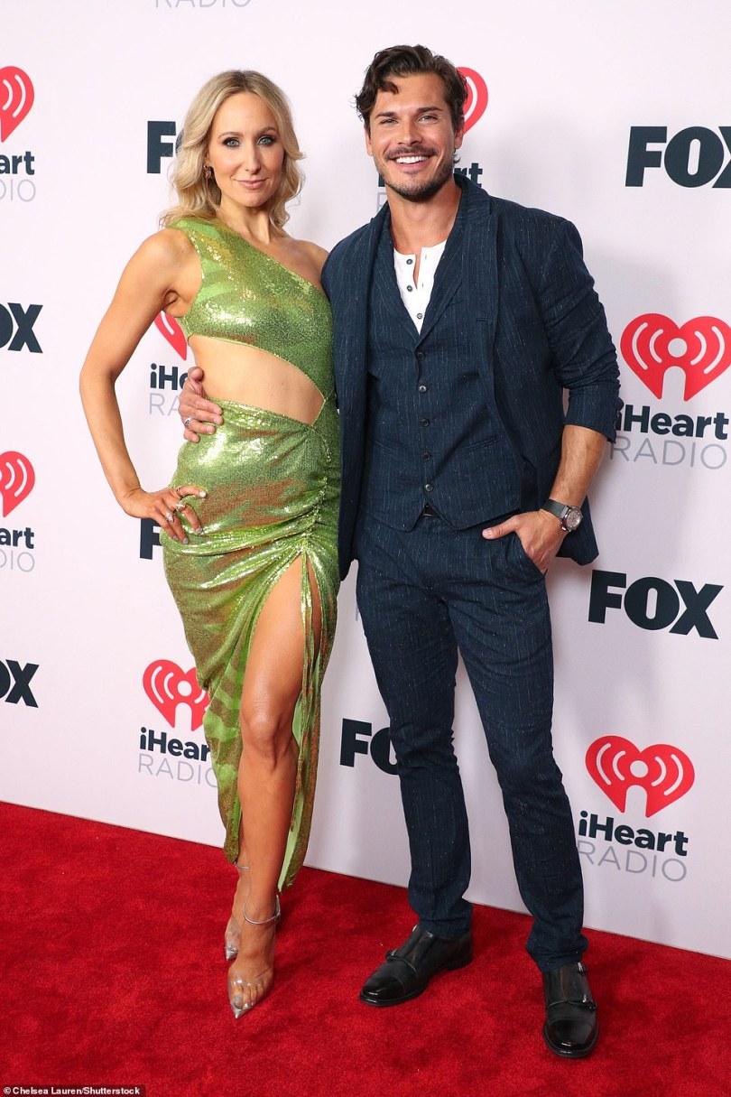 Perfect pair:Nikki Glaser and Gleb Savchenko walk the carpet in style