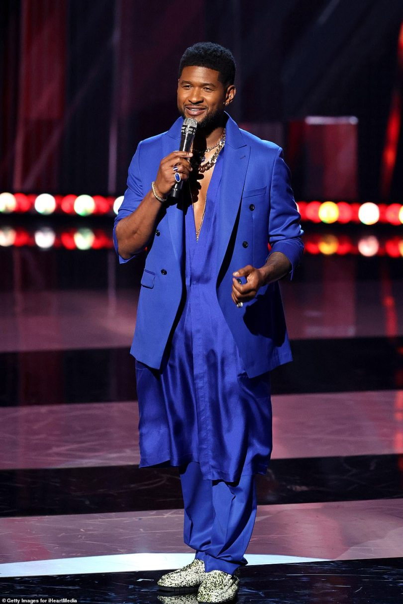 Host: Usher hosted the annual ceremony, first taking to the stage in a blue oversized suit