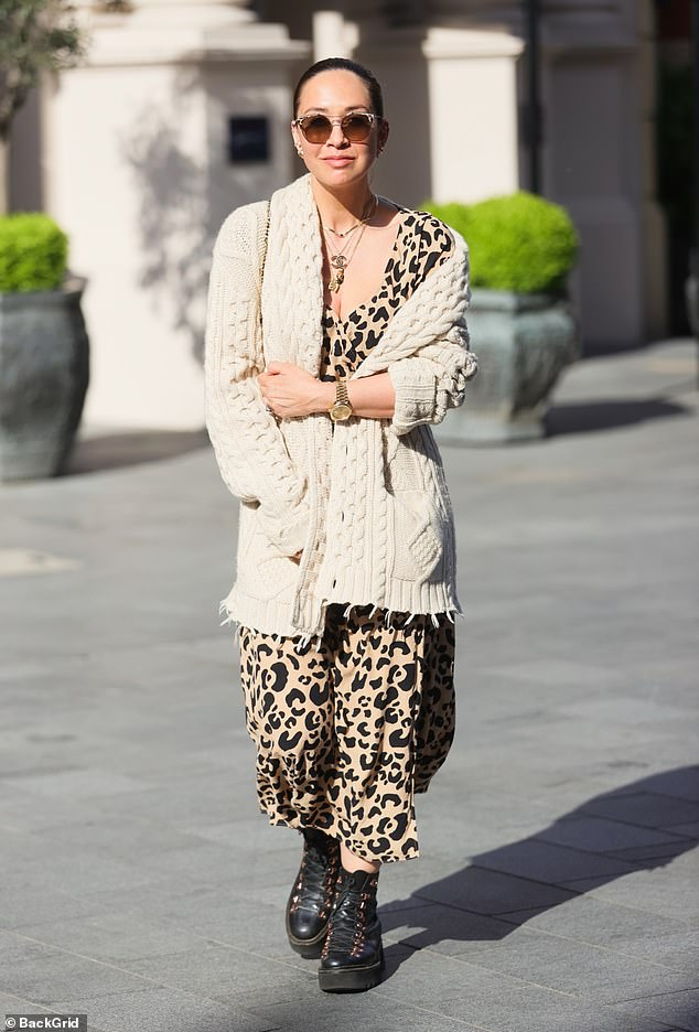 Chic: Myleene Klass cut a stylish figure in a plunging leopard print dress as she arrived at Global Radio Studios in London on Friday