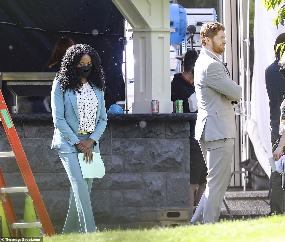 Jordan Dean was seen relaxing on set as Prince Harry with a woman who looked chic in a blue suit, whose name is unknown