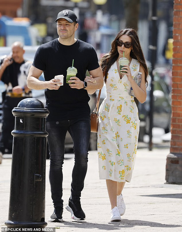 Having a great time: The pair seemed in high spirits as the strolled along the street chatting