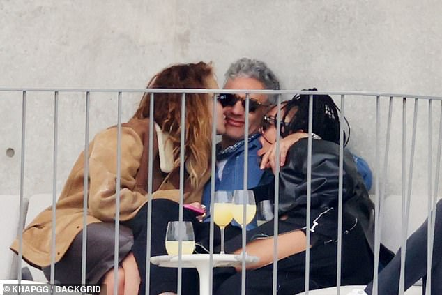 'Not the image they're looking for': Taika Waititi, 45, (centre) was reportedly 'reprimanded by Marvel bosses' over photos of him cosying up with girlfriend Rita Ora, 30, (left) and Tessa Thompson, 37, (right)