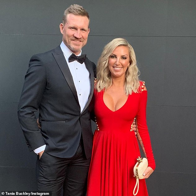 Over:Tania split from ex-husband Nathan Buckley (left) in January last year, but did not confirm their break-up until December