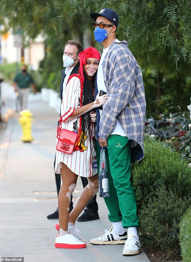 Cute: Winnie Harlow looked more loved-up than ever as she cuddled her NBA star boyfriend Kyle Kuzma after a romantic lunch in West Hollywood on Friday
