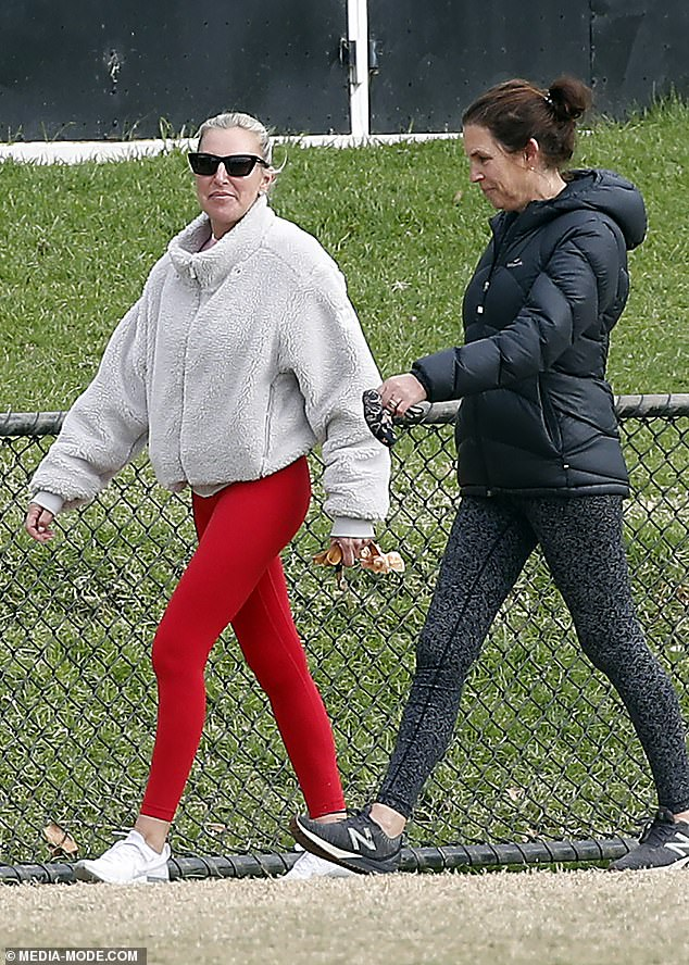 Dressed down:Tania appeared to skip the makeup for her outing, and had her blonde hair back in a ponytail