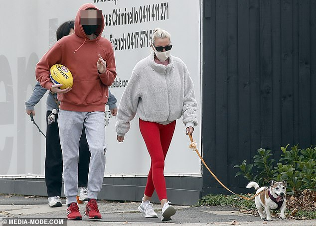 Out and about:Tania Buckley (née Minnici) headed out for some exercise on Saturday, amid Melbourne's lockdown.The former WAG took a stroll with her dog, and her sons Jett, 14, and Ayce, 12. All pictured