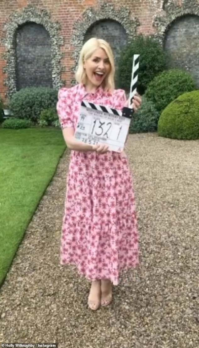 Cameo:Holly Willoughby could hardly contain her delight while brandishing a clapperboard as she prepared to film her scene on Midsomer Murders