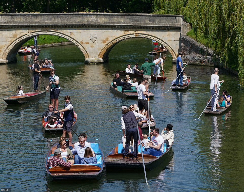 Plans to go ahead with 'Freedom Day' on June 21 hang in the balance because of the rapid spread of the Indian variant, with cautious scientists calling for ministers to delay the final step on the roadmap back to normality. Pictured:People enjoy punt tours along the River Cam in Cambridge today