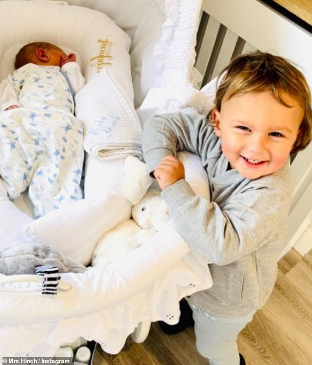 Brotherly love:Mrs Hinch has shared an adorable snap of the moment her eldest child Ronnie met his baby brother on Friday