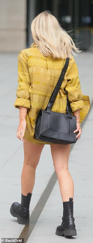 Looking good: Mollie made a style statement in her mustard and black ensemble