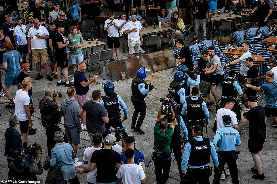 Joyous scenes at Ribeira in Porto quickly escalated as police officers armed with riot gear descended on football fans