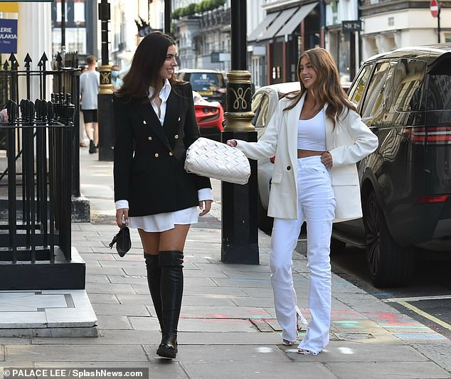 Stylish:Francesca donned a black tailored jacket worn over a crisp white shirt and a thigh-grazing mini-skirt while Georgia cracked a joke