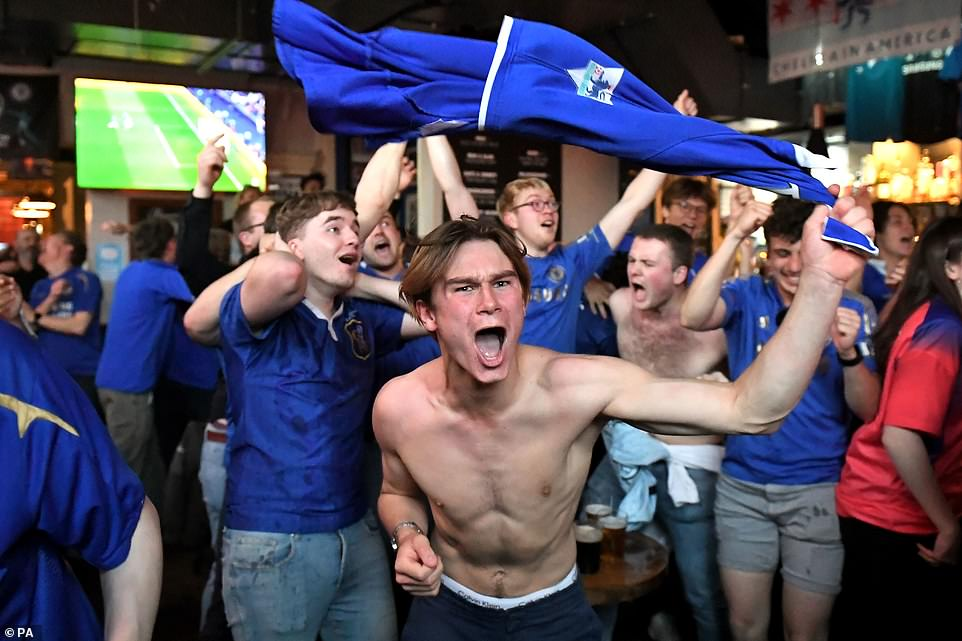 Chelsea fans celebrate their side's first goal of the game at The Chelsea Pensioner pub in London