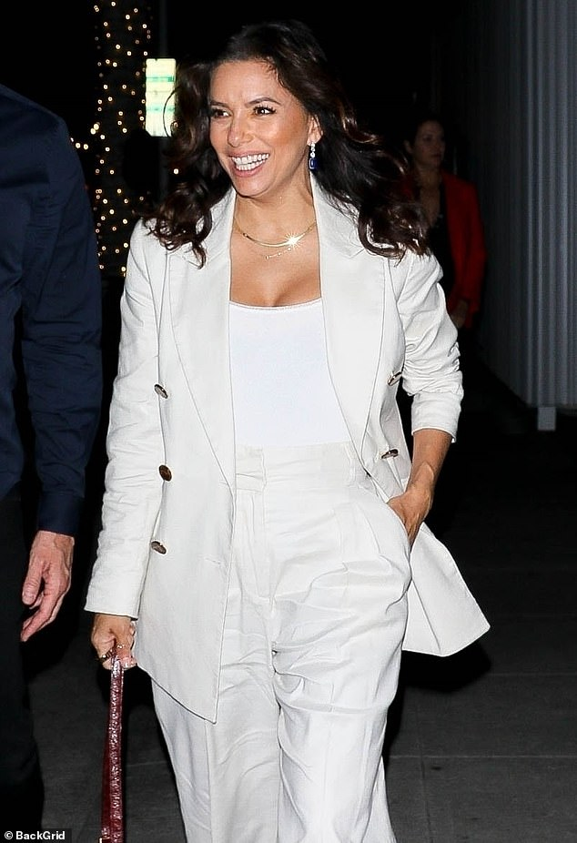 Dressed to impress: Eva Longoria was seen wearing a white double-breasted jacket while stepping out with a group of her friends in Beverly Hills on Friday night