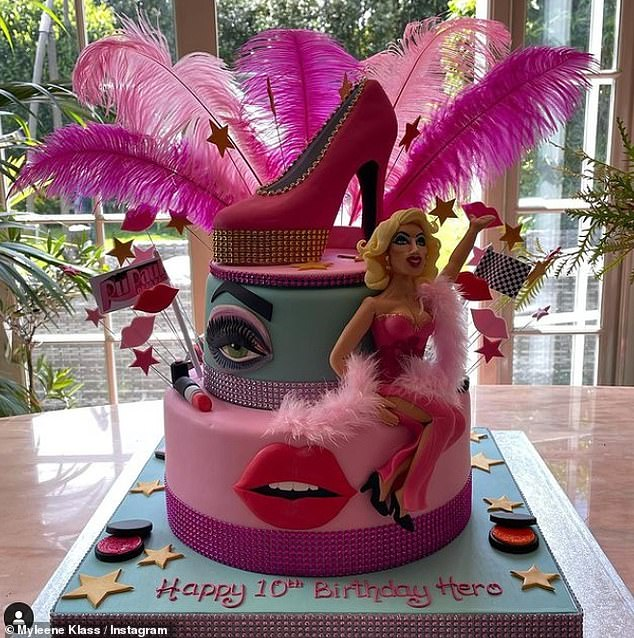Yum!Hero was also given a three-tiered birthday cake that featured feathers, a giant heel and a mini drag queen on the front