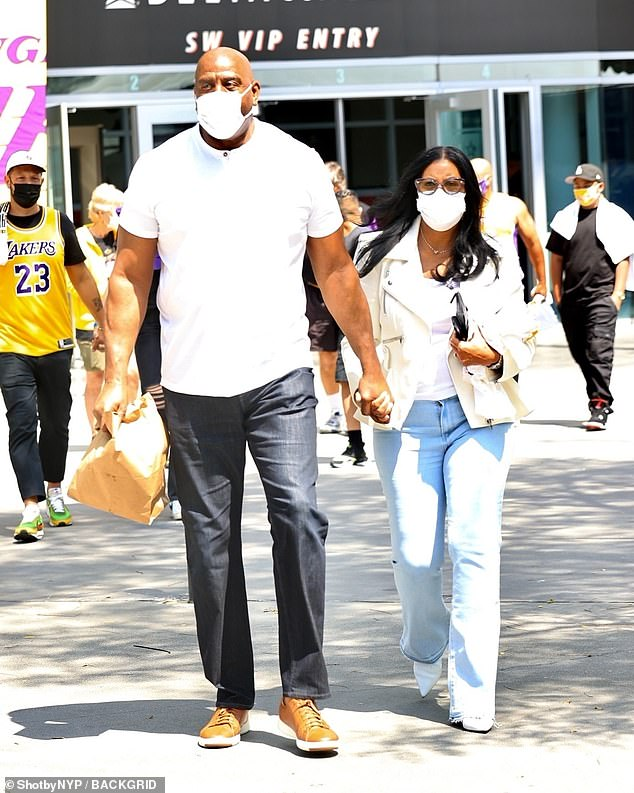 Look who's here! Basketball icon Magic Johnson and his wife Cookie were also spotted leaving the arena