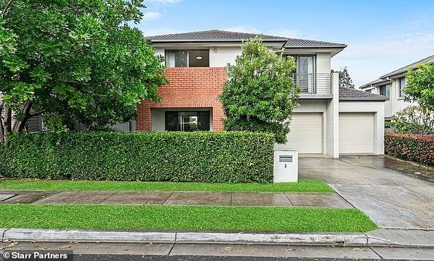 A predicted 21 per cent rise would see Sydney's mid-point price climb by $213,224 by the end of this year to $1.229million. Pictured is an Auburn house, price guide$970,000 to $1,050,000